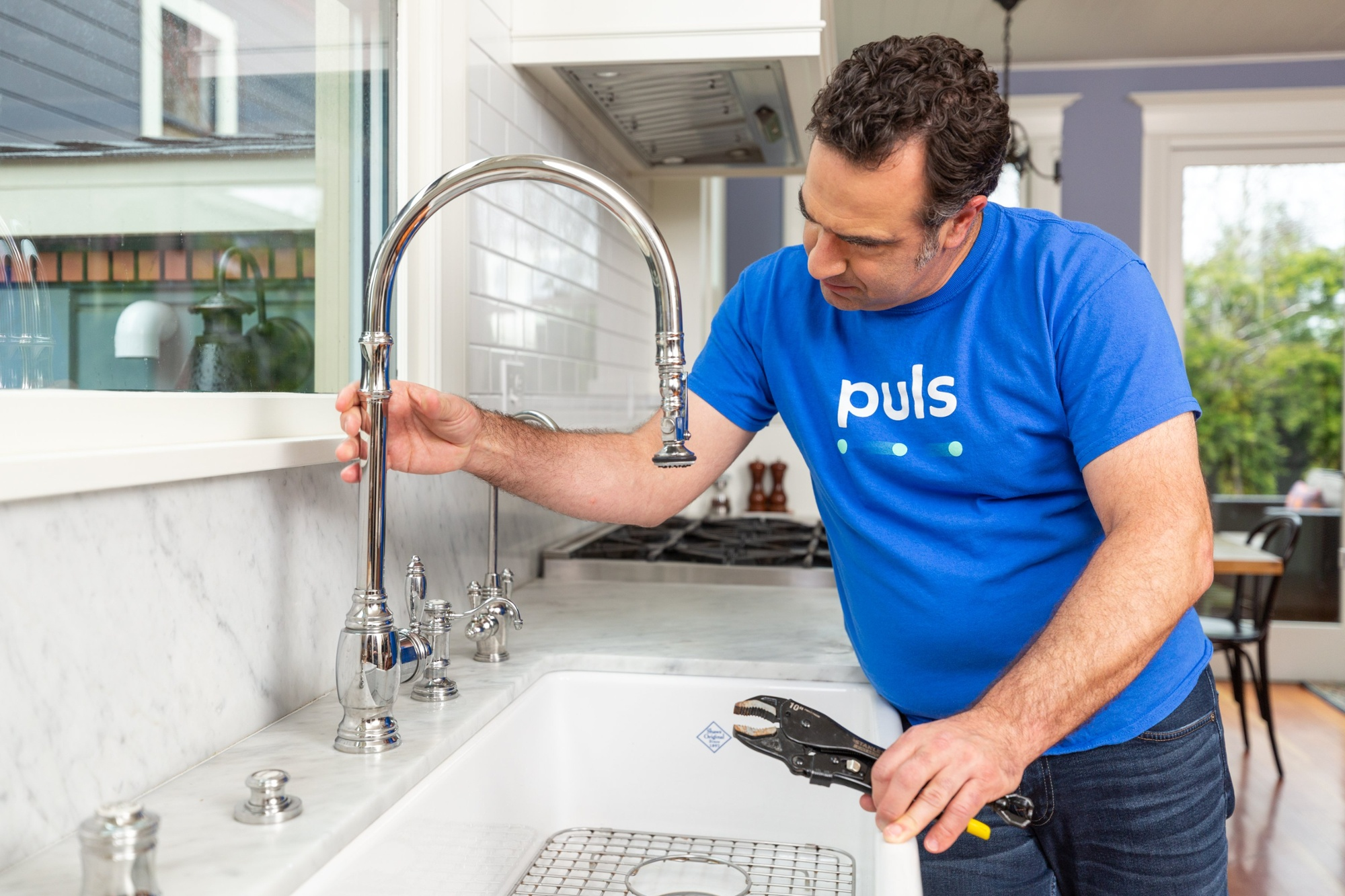 Puls technician replacing kitchen faucet